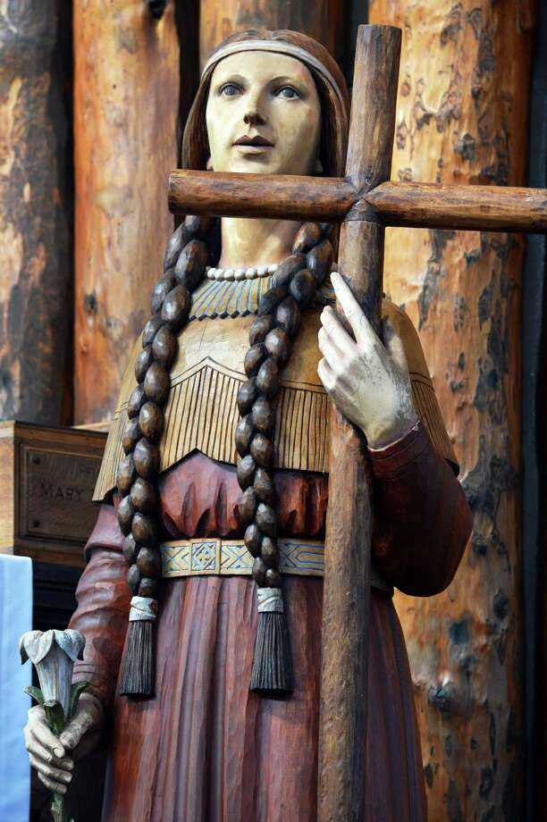 A statue of Kateri Tekakwitha in the coliseum at the Shrine of Our Lady of Martyrs in Auriesville Wednesday Oct. 17, 2012.  Kateri  will be  canonization at the Vatican in Rome Sunday.(John Carl D'Annibale / Times Union) Photo: John Carl D'Annibale / 00019706A