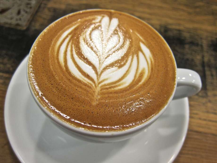 A flat white espresso drink from Greenway Coffee.