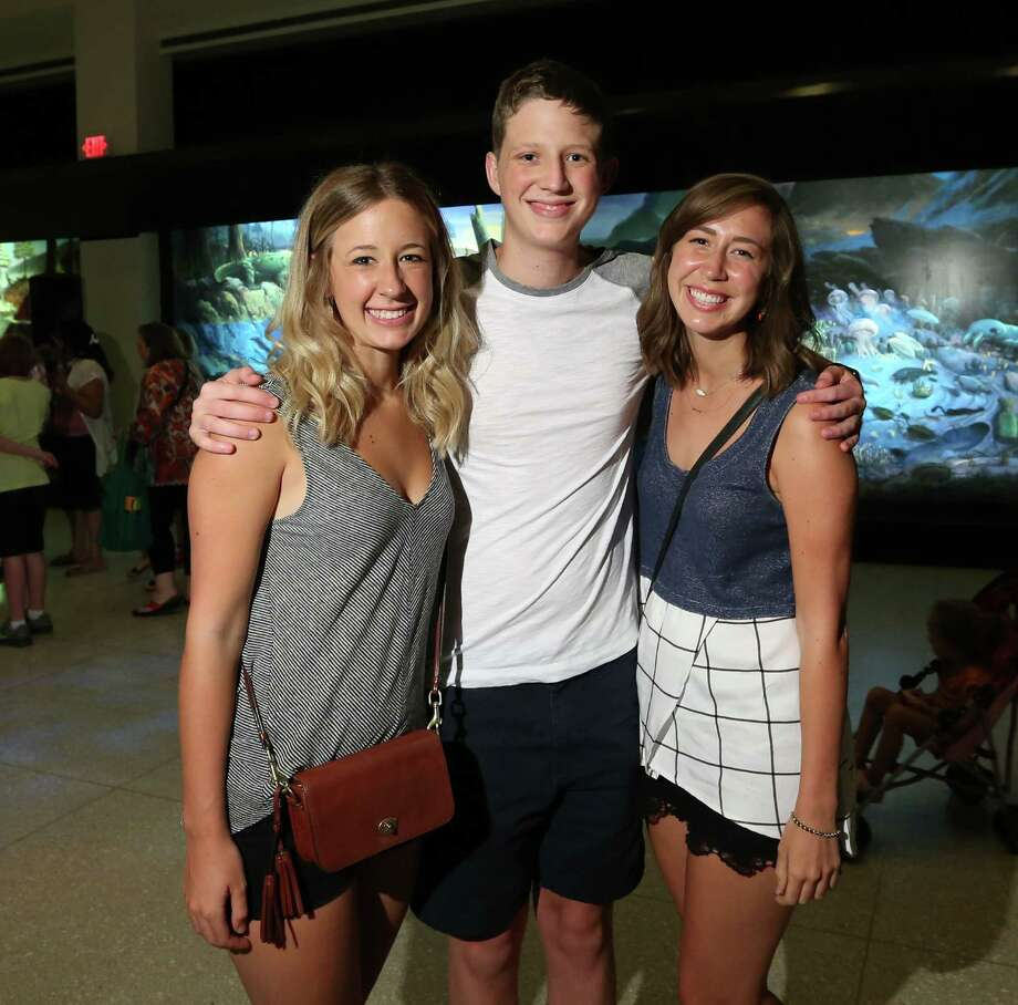 Fans pose for a photo at the Houston Museum of Natural Science Friday, Aug. 7, 2015, in Houston. Photo: Jon Shapley, Houston Chronicle / © 2015 Houston Chronicle