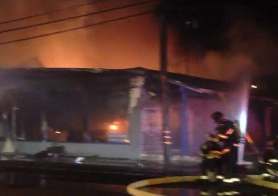 A four-alarm fire gutted two businesses Monday morning in San Leandro. No one was injured in the blaze. Photo: Alameda County Fire