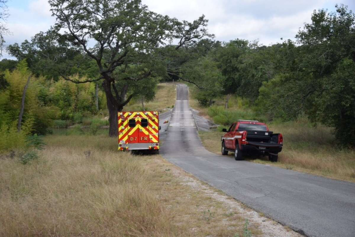 Emergency crews search for a man believed to have fallen off a cliff while riding a horse in San Geronimo Creek north of Helotes on August 10, 2015.