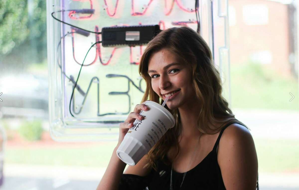 She ditched the typical fake diploma-holding pose for a few to-go cup sipping ones to let her funny, foodie personality shine through.