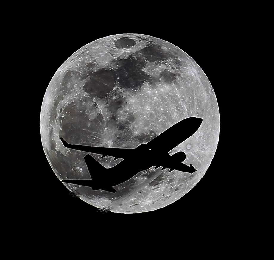 An airliner crosses the moon's path, Monday, April 14, 2014, above Whittier, Calif., approximately one hour before a total lunar eclipse. Then, on April 29, the Southern Hemisphere will be treated to a rare type of solar eclipse. In all, four eclipses will occur this year, two lunar and two solar Photo: Nick Ut, ASSOCIATED PRESS