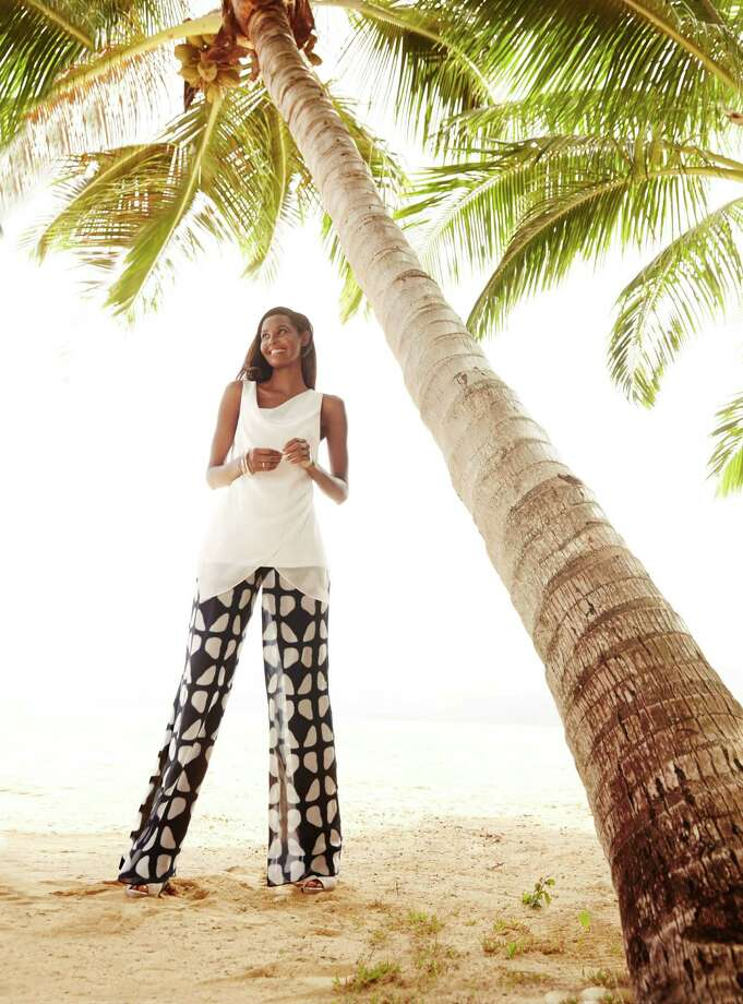 A white asymmetrical top plays to the season's white trend over a tribal print trouser. Blouse, $59.50; wide leg pants, $69.50; wedge sandal, $79.50; all by Alfani, Macy's. Photo: Courtesy Macy's / San Antonio Express-News