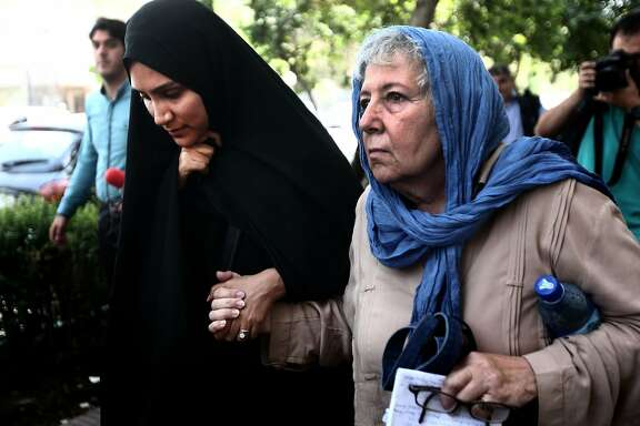 Mary Rezaian (R), the mother of detained Washington Post correspondent Jason Rezaian and his wife Yeganeh Salehi (L) leave the Revolutionary Court after a hearing on August 10, 2015 in the capital Tehran. The trial of 39-year-old Iranian-American journalist, Jason Rezaian who has been in custody for more than a year, resumed behind closed doors, in what could be the final hearing before a judgment is issued on whether he spied on Iran. AFP PHOTO / BEHROUZ MEHRIBEHROUZ MEHRI/AFP/Getty Images