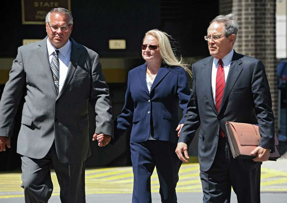Former Halfmoon Supervisor Melinda Wormuth and her husband Larry arrive at the US District Courthouse with her attorney E. Stewart Jones on Monday, Aug. 10, 2015 in Albany, N.Y. Wormuth pleaded guilty to extortion and lying to FBI agents and faces up to a year in prison at her sentencing scheduled for Dec. 10. (Lori Van Buren / Times Union) Photo: Lori Van Buren / 00032952A