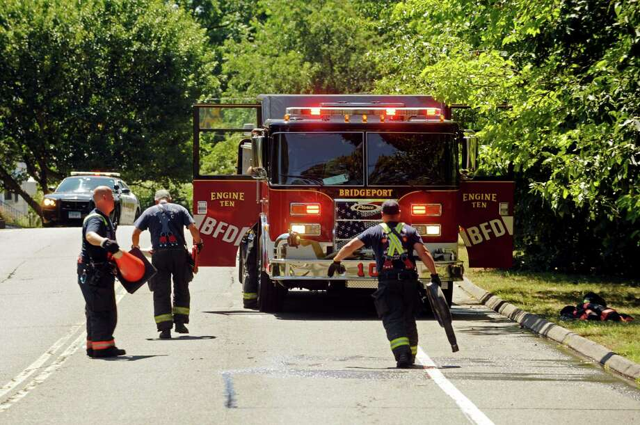 Firefighters pack up after responding to a small brush fire that broke out in Beardsley Park in Bridgeport, Conn. shortly before noon on Monday, Aug. 10, 2015. Photo: Cathy Zuraw / Hearst Connecticut Media / Connecticut Post