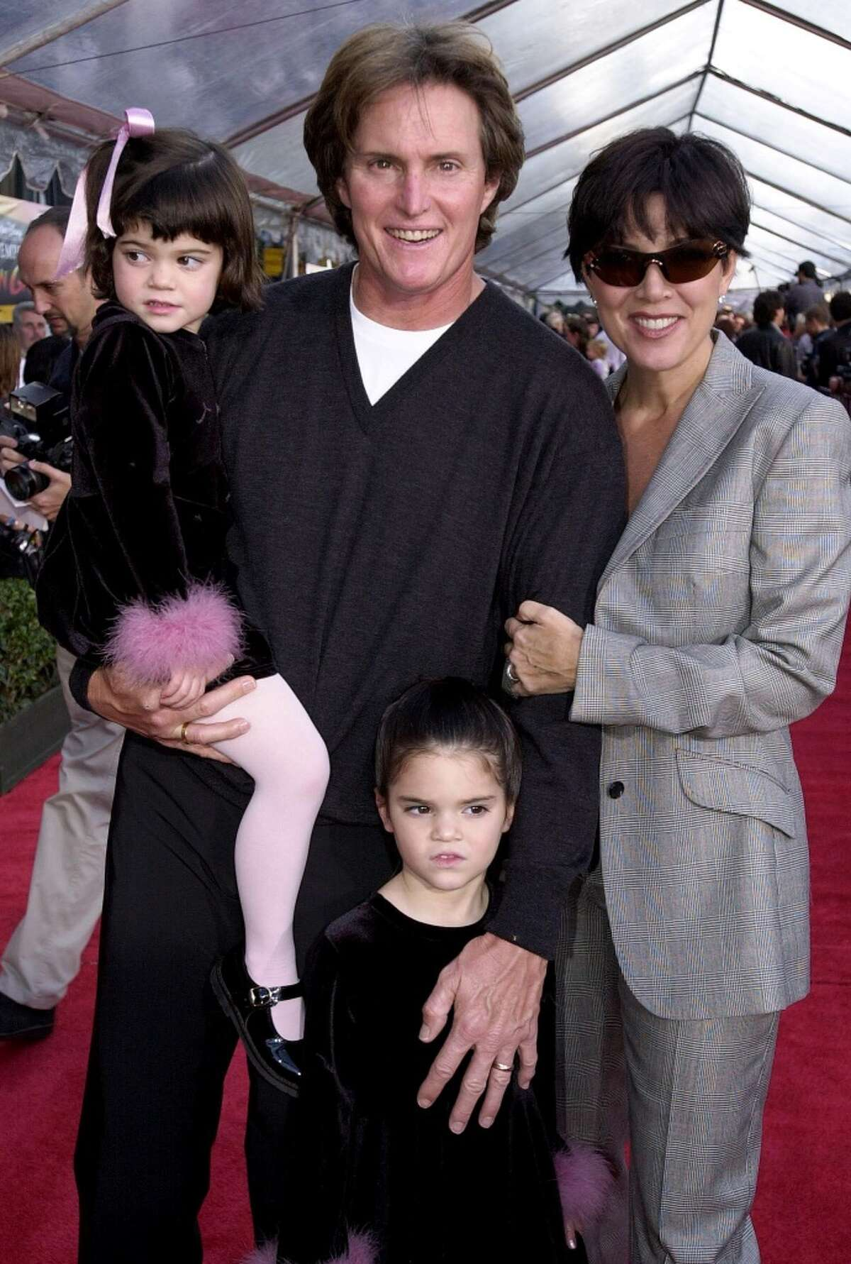 ormer US gold medal decathlete Bruce Jenner (C), his wife Kris (R) and children Kylie (L) and Kendall (BELOW) appear at the, 10 December 2000, premiere of Walt Disney's 'The Emperor's New Groove' at the El Capitan Theater in Hollywood, CA. The film opens in the US on 15 December 2000 AFP Photo/Scott NELSON (Photo credit should read Scott Nelson/AFP/Getty Images)