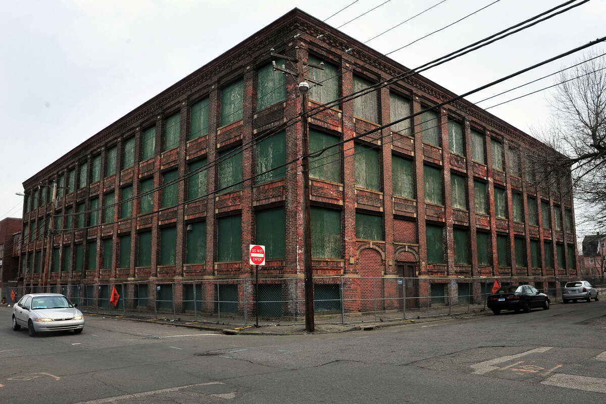Part of the former Warnaco factory, seen from Myrtle Avenue in Bridgeport. A developer hopes to tear down the structure and replace it with an eight-story apartment building.