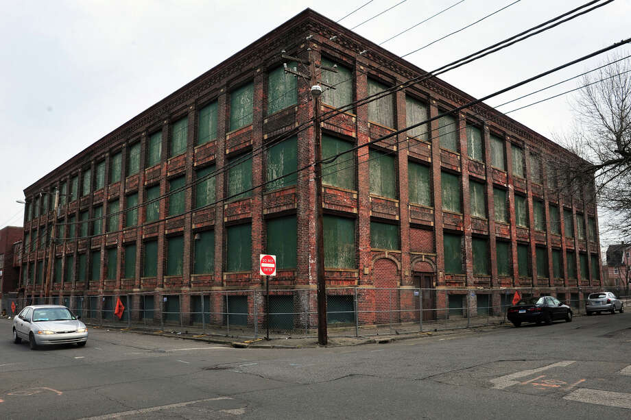 Part of the former Warnaco factory, seen from Myrtle Avenue in Bridgeport. A developer hopes to tear down the structure and replace it with an eight-story apartment building. Photo: Ned Gerard / Ned Gerard / Connecticut Post