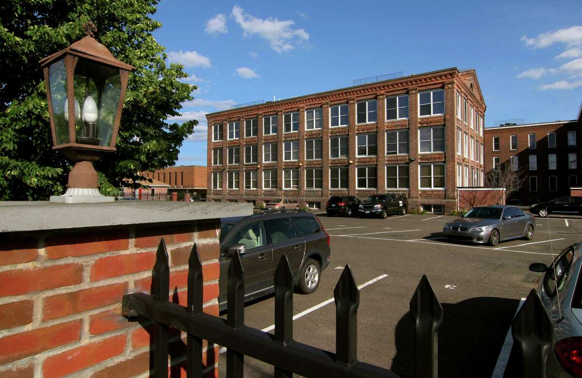 Apartments have been built out of the half of the former Warnaco factory complex at Myrtle Avenue and Lafayette Street in Bridgeport. Plans are in place to tear down and rebuild the other half.