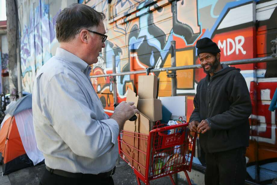 Ian Birchall talks with Bernard Williams, a homeless man who has been in the neighborhood for five years but who keeps to himself and does not participate in the theft and crime that is rampant  in the South Van Ness Ave area on Monday, August 10, 2015. Photo: Amy Osborne, Special To Chronicle