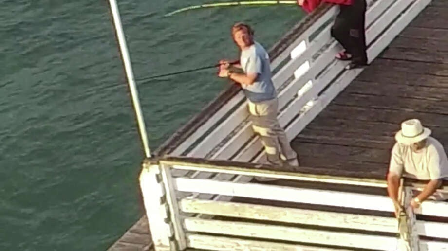 A drone operator had his drone snagged by a fisherman off a San Diego pier. Photo: YouTube