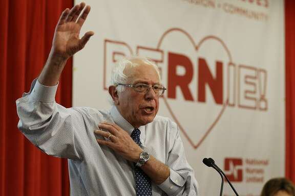 Democratic presidential candidate Sen. Bernie Sanders, I-Vt., gestures while speaking to nurses during a visit to the National Nurses United office Monday, Aug. 10, 2015, in Oakland, Calif. (AP Photo/Eric Risberg)