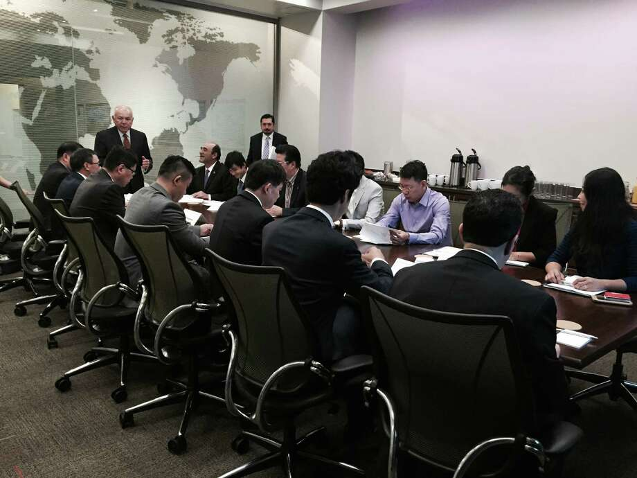 Free Trade Alliance San Antonio CEO and President Jose Martinez (standing at the end of the table) on Monday addresses Chinese executives looking to buy U.S. goods for Chinese online sales. Photo: David Hendricks /San Antonio Express-News