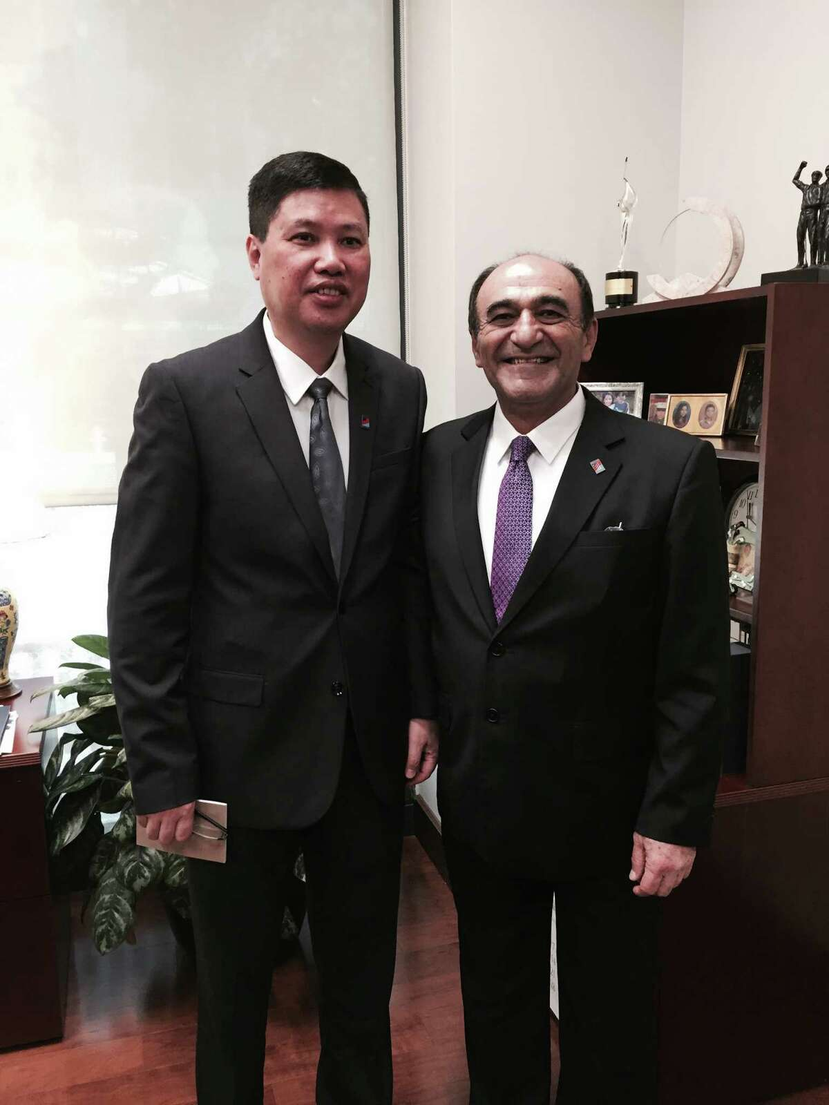 Harley Seyedin (right), president of the American Chamber of Commerce in South China, organized the delegation visit to San Antonio. He recruited executives of 10 Chinese companies, including He Chaoping, chairman of Guangdong Guangxin Trade Development Co., for the buying and investment mission to San Antonio this week.