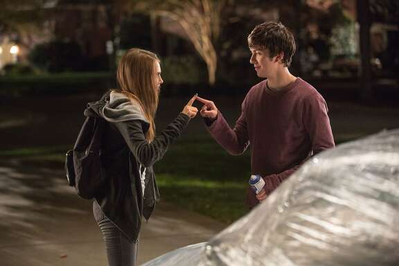 "This photo provided by Twentieth Century Fox shows longtime neighbors, Cara Delevingne, left, as Margo, and Nat Wolff as Quentin in a scene from the film, ""Paper Towns.""  (Michael Tackett/Twentieth Century Fox via AP)"