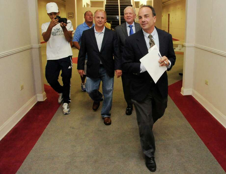 Joseph P. Ganim heads to Bridgeport Mayor Bill Finch's office to deliver his Office of  Public Integrity proposal Monday. Photo: Cathy Zuraw / Hearst Connecticut Media / Connecticut Post