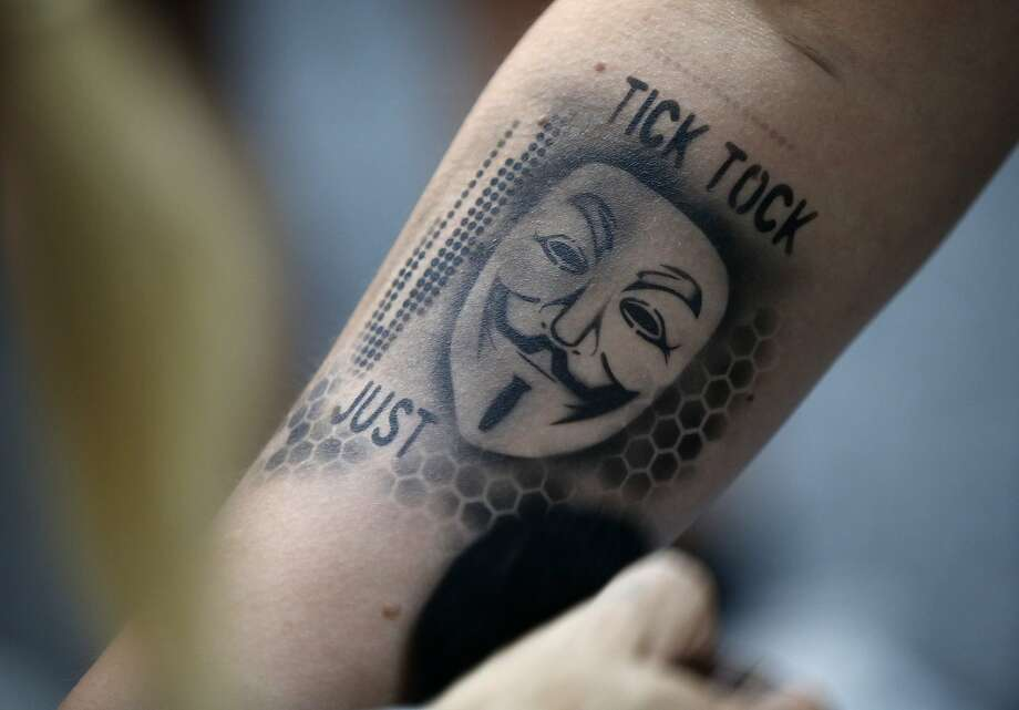 An attendee gets an airbrushed tattoo during the Black Hat conference Thursday, Aug. 6, 2015, in Las Vegas. The annual computer security conference draws thousands of hackers and security professionals to Las Vegas. (AP Photo/John Locher) Photo: John Locher, Associated Press