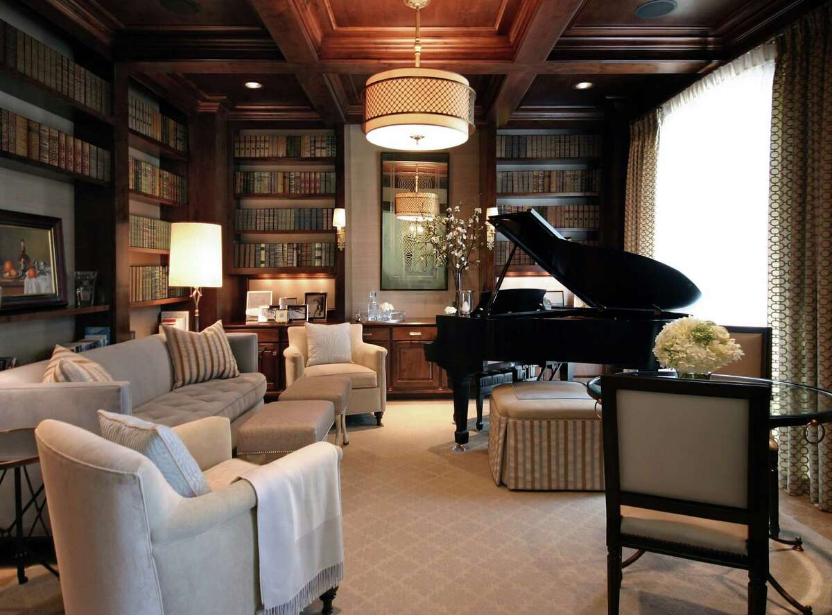 AFTER: Designer Ben Johnston used a cool, neutral color palette to brighten the room and made the Steinway piano a focal point.