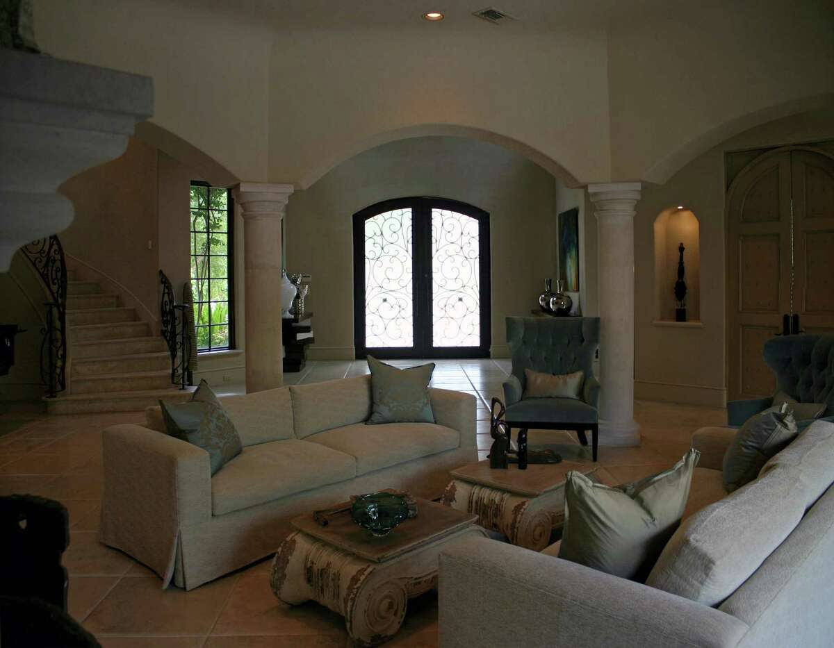 BEFORE: This Mediterranean-style home had wide-open spaces but decor that seemed common and small-scale.