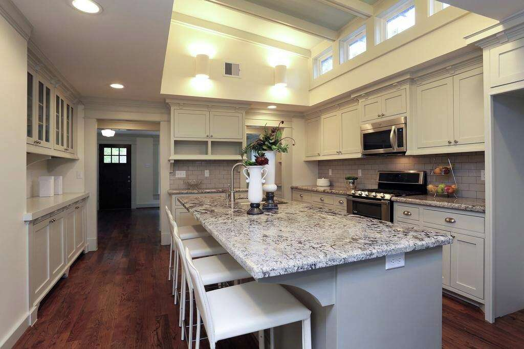 jamie house transformed the space with light surfaces modern cabinets and a