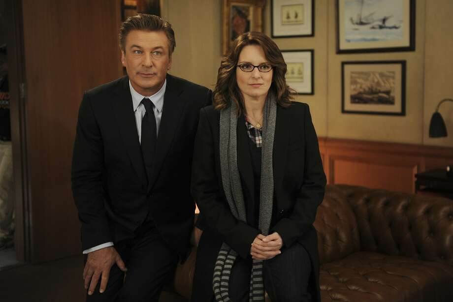 """The Professional too Busy for Love: Work, work, work, climb, climb, climb. Who has time for connections with a career to build? Eventually one too many dinners-for-one leads to either a re-evaluation, or a personal crisis. Seen here, Alec Baldwin as Jack Donaghy, left, and Tina Fey as Liz Lemon in the television comedy """"30 Rock."""" Photo: Ali Goldstein, Associated Press"""