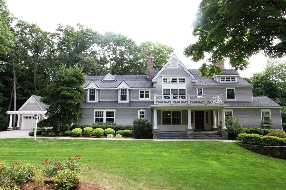 This Colonial on Carter Street in New Canaan was renovated and expanded in 2005. Photo: Contributed / Contributed Photo / New Canaan News