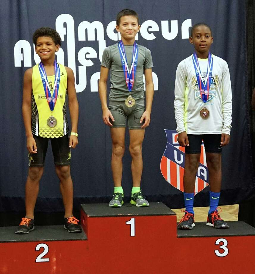 Westport's Luke Villaluz, center, stands atop the podium in his age group of the AAU Junior Olympics held last week in Hampton Roads, Virginia. Villaluz participated in the All Sports Combine, featuring five seperate events. Photo: Contributed Photo / Westport News Contributed