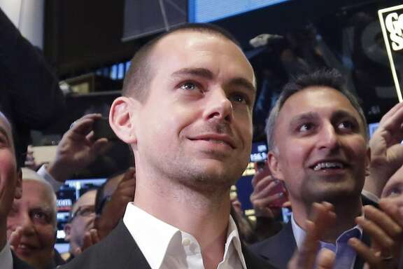 FILE - In this Nov. 7, 2013 file photo, Twitter Chairman and co-founder Jack Dorsey applauds during the ringing of the opening bell at the New York Stock Exchange. While some analysts expect Dorsey, currently serving as the company's interim CEO, to be hired to the permanent post, this would mean giving up his job at Square, the payments startup. (AP Photo/Richard Drew, File)