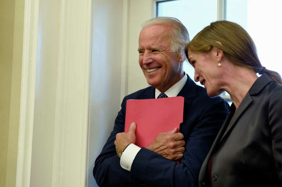 Vice President Joe Biden talks with U.S. United Nations Ambassador Samantha Power as they attend a meeting last week. Speculation is increasing about a possible Biden presidnetial bid. Photo: Susan Walsh /Associated Press / AP