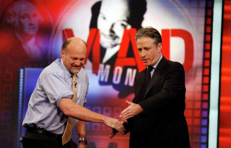 "FILE - In this March 12, 2009 file photo, Jim Cramer, left, host of the CNBC ""Mad Money"" show, is welcomed by host Jon Stewart during an appearance on Comedy Central's ""The Daily Show with Jon Stewart"" in New York. After hosting nearly 2600 editions, Stewart will sign off for good on Aug. 6.   (AP Photo/Jason DeCrow, FIle) Photo: Jason DeCrow, FRE / FR103966 AP"