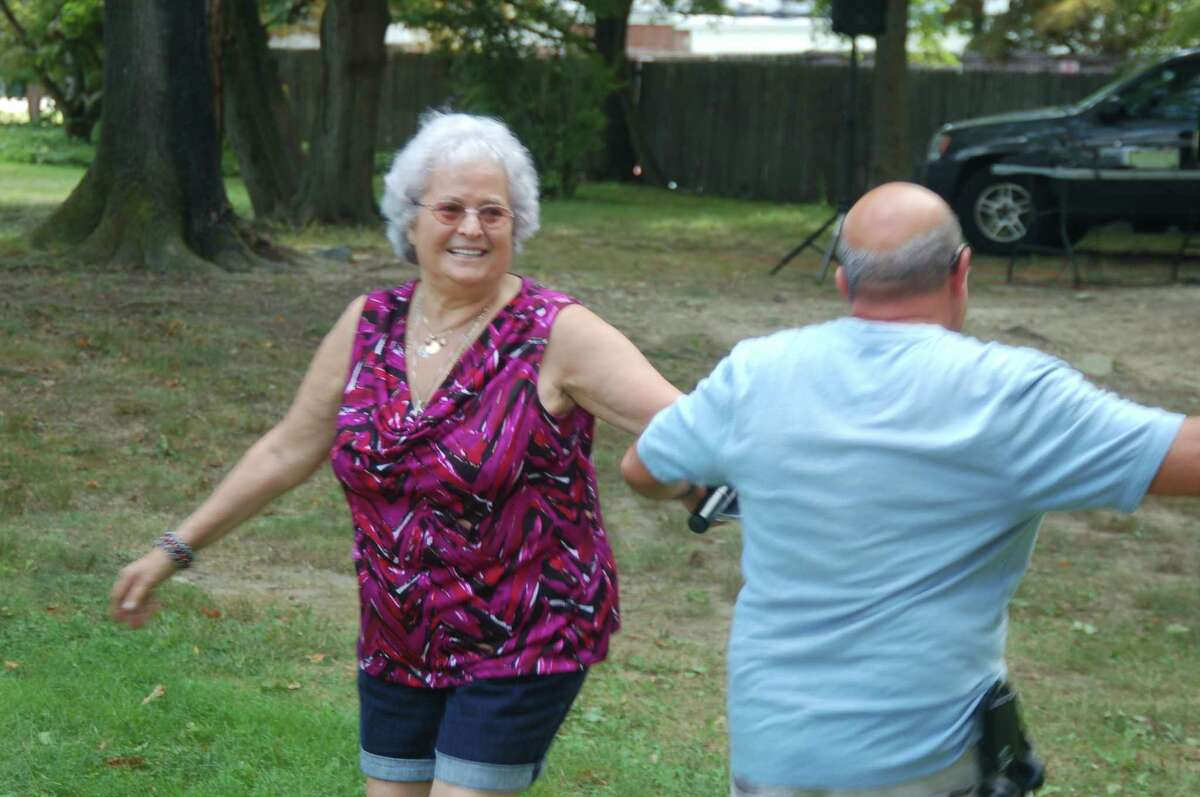 As part of the Fest of St. Lawrence celebration, Filomena Castrovillari shares a dance with Giuseppe Leale.