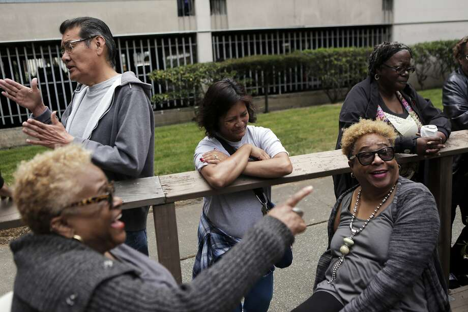 Neighbors talk together during a neighborhood barbecue at Midtown Park Apartments in San Francisco on Monday, Aug. 10, 2015. Residents have been trying to stick together as they fight the rising rent costs in the apartment complex. Photo: Dorothy Edwards, The Chronicle