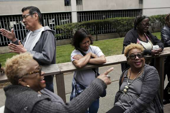 Neighbors talk together during a neighborhood barbecue at Midtown Park Apartments in San Francisco on Monday, Aug. 10, 2015. Residents have been trying to stick together as they fight the rising rent costs in the apartment complex.