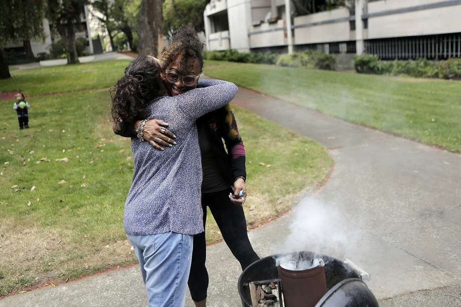 UC Berkeley law student Alison Ganem, left, hugs Midtown resident Phyllis Bowie during a neighborhood barbecue at Midtown Park Apartments in San Francisco on Monday, Aug. 10, 2015. Ganem has been giving the residents of Midtown Park Apartments legal advice as they fight the rising rent costs. Photo: Dorothy Edwards, The Chronicle