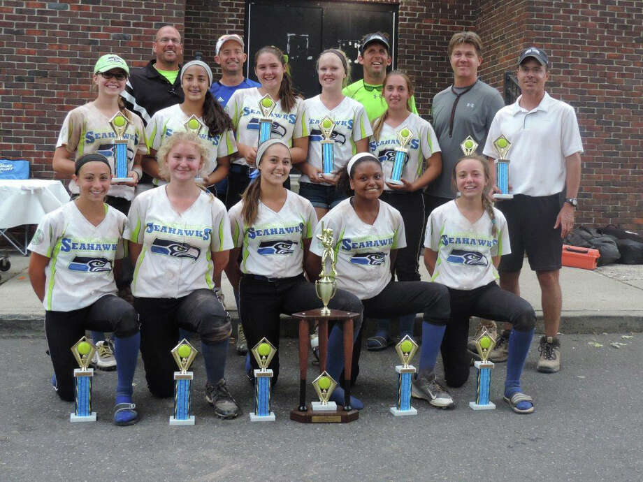 The 13U CT Seahawks won the Fairfield County Fastpitch Softball League 14U tournament and league championships.  They won five tournaments this season and finished with a 60-21-3 record.  Team members include, front row, from left, Maggie Coffin, Lizzie Kane, Ava Dunn, Haley Bivens and Maggie Britt; second row, Gretchen Bunovsky, Brianna Catino, Maddie McGarry, Olivia Vadas and  Madison Procyk; back row, coaches Dan Coffin, Mike Britt, Mike Procyk, Jim Vadas, and Ron Bunovsky. Photo: Contributed / Contributed Photo / Connecticut Post Contributed