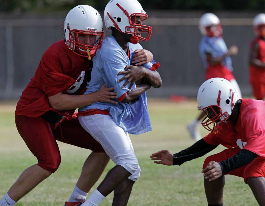 Bellaire football players go through the first day of practice Monday. The Cardinals have a new head coach in Herb Kunz, who was promoted after serving as defensive coordinator last year.  (Melissa Phillip  / Houston Chronicle ) Photo: Melissa Phillip, Staff / © 2015 Houston Chronicle
