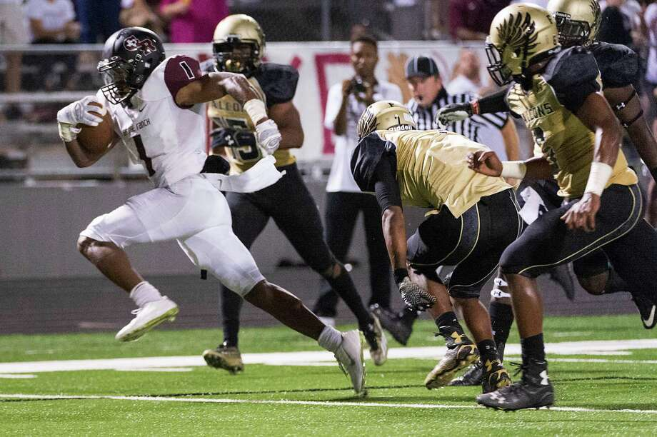 George Ranch running back Darius Anderson (1) races through the Foster defense for a touchdown during the first half of a high school football game at  Traylor Stadium, Friday, Oct. 10, 2014, in Rosenberg. ( Smiley N. Pool / Houston Chronicle ) Photo: Smiley N. Pool, Staff / © 2014  Houston Chronicle