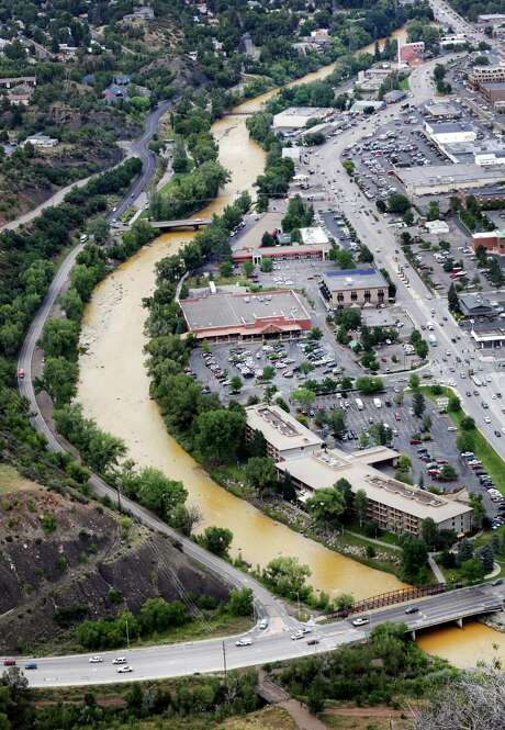 Toxic sludge flows down the Animas River through Durango Colo., on Friday after the spill from an abandoned gold mine Wednesday. Photo: Jerry McBride /Associated Press / The Durango Herald