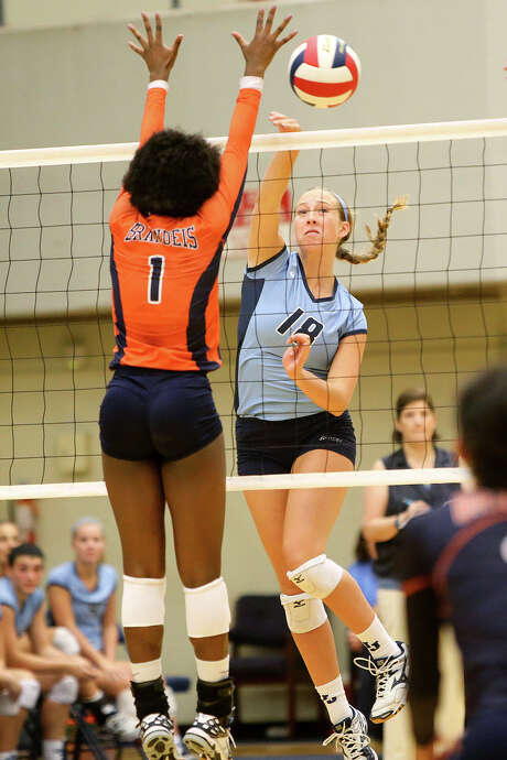 Johnson's Kylie Rittimann (right) gets a shot past Brandeis's Jordan Jefferson during their season-opening volleyball match at Paul Taylor Field Housel on Monday, Aug. 10, 2015. Johnson won the match in four sets, 22-25, 25-13, 25-14, 28-26.  Rittimann led the Lady Jaguars with 14 kills in the match.  MARVIN PFEIFFER/ mpfeiffer@express-news.net Photo: Marvin Pfeiffer, Staff / San Antonio Express-News / Express-News 2015