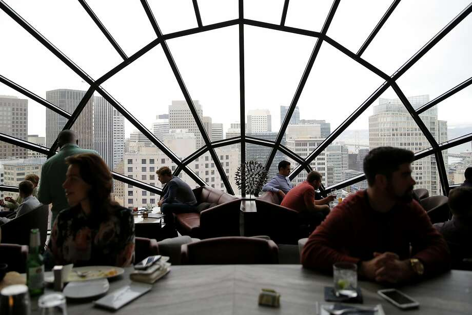The view is terrific from the View Lounge on the 39th floor of the downtown Marriott Marquis, where patrons can drink in the heady atmosphere, above, as well as a cocktail, below. San Francisco has only three remaining such top-floor venues. Photo: Connor Radnovich, The Chronicle