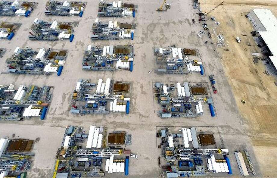 Idle oil drilling rigs are seen Tuesday April 14, 2015 at the still-under-construction Helmerich & Payne, Inc. south Texas operations center in Sequin just north of I-10 off of Hwy. 123. (William Luther/San Antonio Express-News)