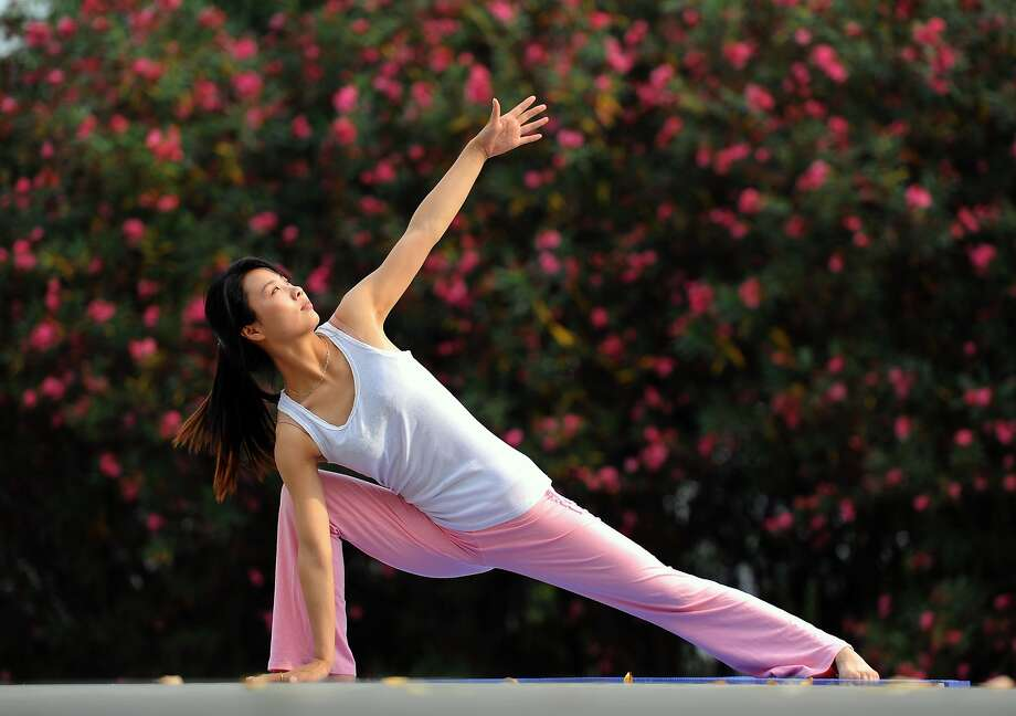 A Dear Abby reader thinks one of her family members post to many risque yoga poses on social media. Photo: ChinaFotoPress