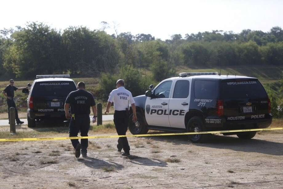 A child's body was found in a bayou near an apartment complex in northwest Houston on Tuesday morning, Aug. 11, 2015. Photo: Cody Duty/Houston Chronicle