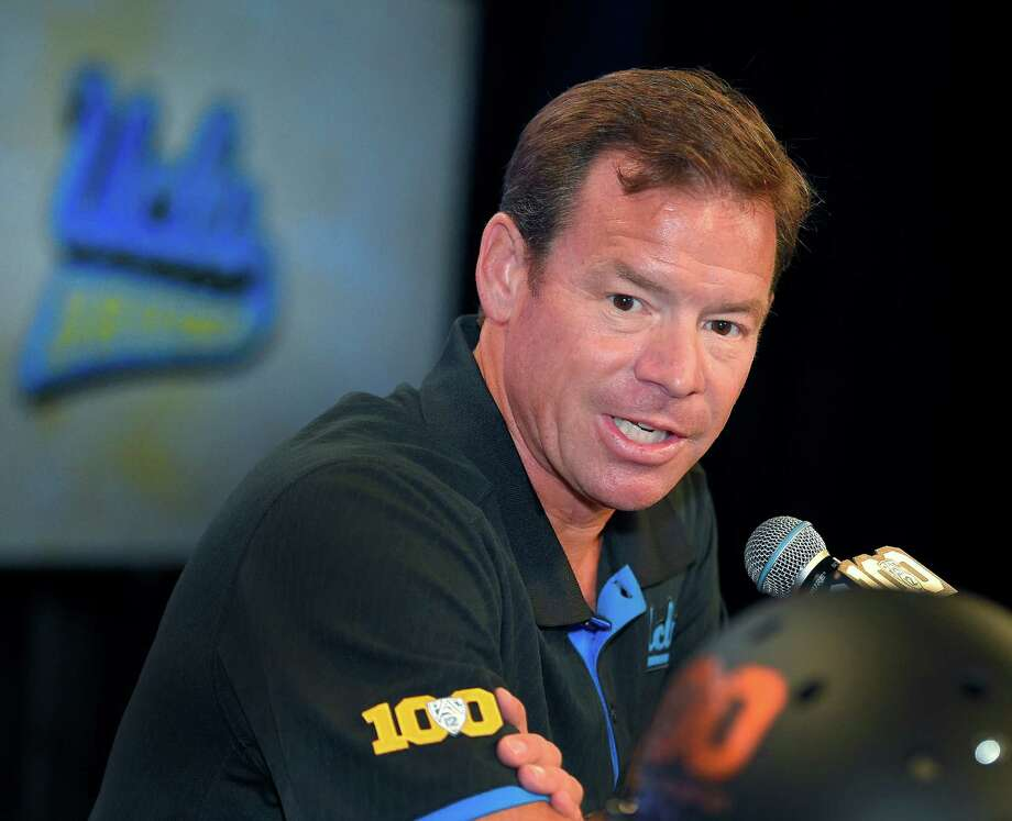 UCLA head coach Jim Mora speaks to reporters during NCAA college Pac-12 Football Media Days in Burbank, Calif., on July 30, 2015. The UCLA Bruins feel they're still searching for national respect even after two straight 10-win seasons and a Top-10 finish last year. They're also looking for a new starting quarterback. Photo: Mark J. Terrill /Associated Press / AP