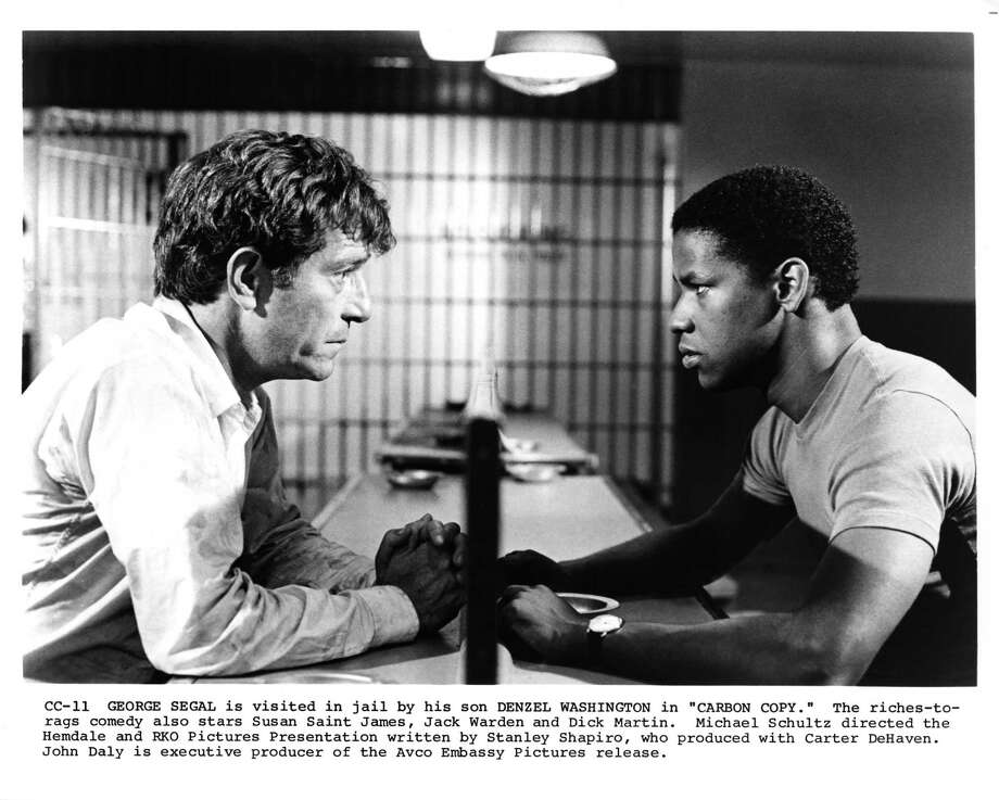 1981:  Actor Denzel Washington and George Segal in a scene for the feature film 'Carbon Copy' produced by Hemdale and RKO in 1981 in Los Angeles, California. Photo: Michael Ochs Archives, Getty Images / Moviepix