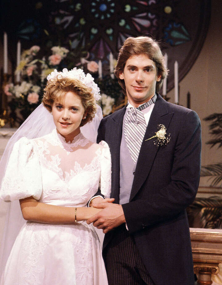 """As the World Turns"" stars Meg Ryan (as Betsy Stewart Montgomery) and Scott Bryce (as Craig Montgomery) in a wedding scene. Photo: CBS Photo Archive, Getty Images / 1983 CBS Photo Archive"