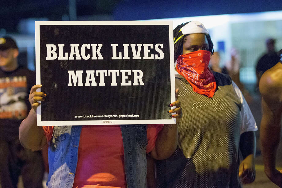 Demonstrators, marking the one-year anniversary of the shooting of Michael Brown, protest along West Florrisant Street on August 10, 2015 in Ferguson, Missouri. Photo: Scott Olson, Wire / 2015 Getty Images