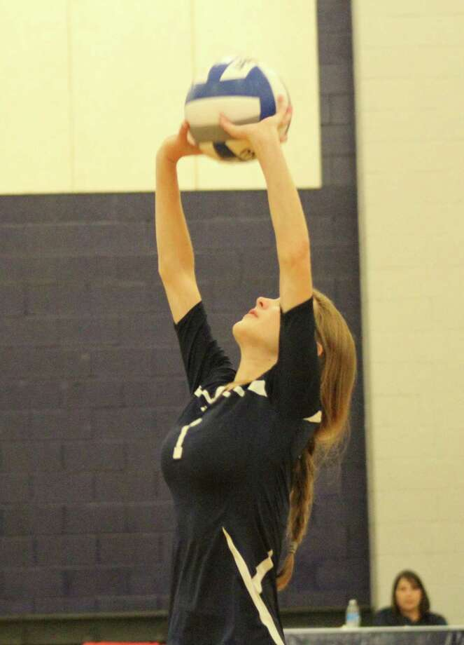 Number 1, Shelby Glover for Emery goes up for the ball vs Westbury Christian. Photo: Jimmy Loyd / freelance
